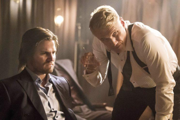 Stephen Amell as Oliver Queen and Dolph Lundgren as Konstantin Kovar (Credit: Katie Yu/The CW)