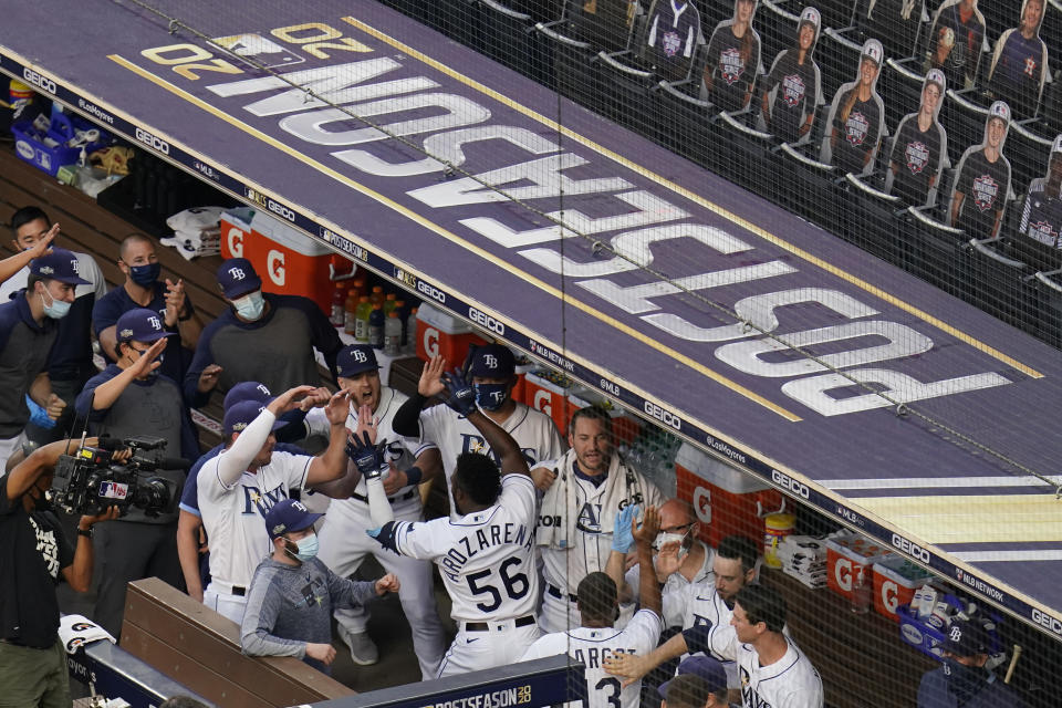 Tampa Bay Rays Randy Arozarena celebrates with his teammates after hitting a two run home run against Houston Astros pitcher Lance McCullers Jr. (43) during the first inning in Game 7 of a baseball American League Championship Series, Saturday, Oct. 17, 2020, in San Diego. (AP Photo/Gregory Bull)