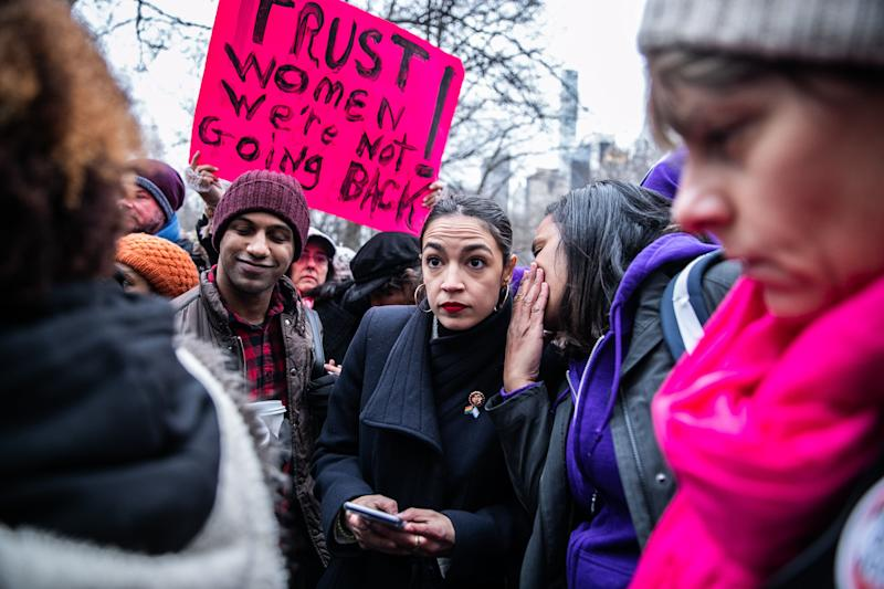 Representative Alexandria Ocasio-Cortez, a Democrat from New York, center, speaks with demonstrators during the third annual Women's March near Columbus Circle in New York, U.S., on Saturday, Jan. 19, 2019. Two years after millions gathered for the inaugural Women's March, demonstrators around the world march again in solidarity with communities of women and allies who seek to create a future of equality, justice, and compassion for all. Photographer: Jeenah Moon/Bloomberg via Getty Images