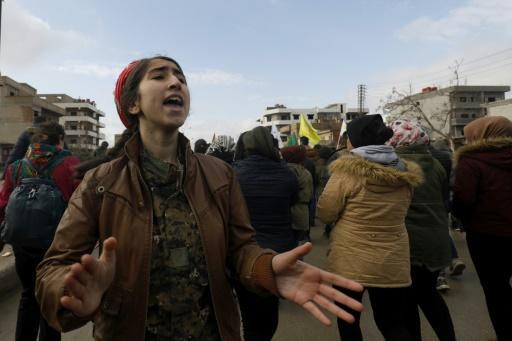Syrian Kurds demonstrate in the northeastern city of Qamishli on December 28, 2018, against Turkish threats of a new cross-border offensive following the US decision to withdraw their troops