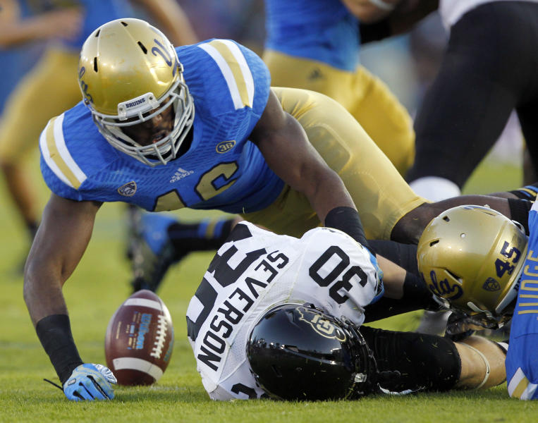 UCLA linebacker Kenny Orjioke, left, and UCLA linebacker Cameron Judge, right, cause Colorado returner Ryan Severson (30) to fumble on a kickoff return, which is recovered by UCLA in the first half of their NCAA college football game Saturday, Nov. 2, 2013, in Pasadena, Calif. (AP Photo/Alex Gallardo)