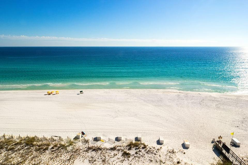 """<p>Unlike your average beach, Destin Beach in north Florida is home to emerald green waters and sugar-white sand. The popular fishing destination is known as the <a href=""""https://www.fishingdestinguide.com/BEACHFISH-Fishing.html"""" rel=""""nofollow noopener"""" target=""""_blank"""" data-ylk=""""slk:""""luckiest fishing village"""""""" class=""""link rapid-noclick-resp"""">""""luckiest fishing village""""</a> thanks to its abundance of redfish, speckled trout, and flounder. In addition to its beach offerings, Henderson Beach State Park and Grayton Beach State Park in Destin are home to stunning nature trails for those who love to hike. </p>"""