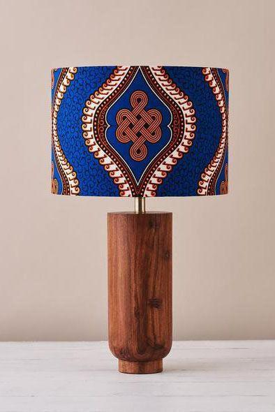 "<p><a class=""link rapid-noclick-resp"" href=""https://bespokebinny.com/collections/lampshades/products/african-wax-print-drum-lampshade-blue-royalty"" rel=""nofollow noopener"" target=""_blank"" data-ylk=""slk:SHOP NOW"">SHOP NOW</a></p><p>British-based business Bespoke Binny creates handmade homeware and gifts using West African cloth. This wax-print drum lampshade will brighten up any room.</p><p>Blue royalty lampshade, £41.99, <a href=""https://bespokebinny.com/collections/lampshades/products/african-wax-print-drum-lampshade-blue-royalty"" rel=""nofollow noopener"" target=""_blank"" data-ylk=""slk:Bespoke Binny"" class=""link rapid-noclick-resp"">Bespoke Binny</a></p>"