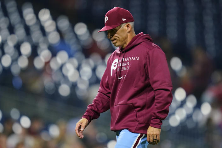 Philadelphia Phillies manager Joe Girardi walks to the dugout after pulling pitcher Ian Kennedy during the ninth inning of a baseball game against the Colorado Rockies, Thursday, Sept. 9, 2021, in Philadelphia. (AP Photo/Matt Slocum)