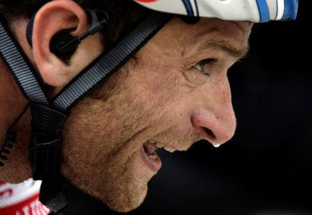 FILE PHOTO: Italy's Scarponi climbs during sixth stage of Giro d'Italia cycling race