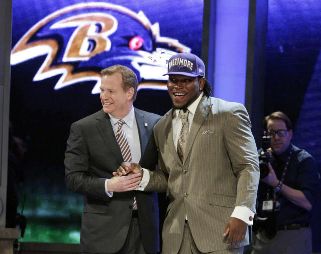 Alabama defensive end Courtney Upshaw, right, poses for photographs with NFL Commissioner Roger Goodell after being selected 35th overall by the Baltimore Ravens in the second round of the NFL football draft at Radio City Music Hall, Friday, April 27, 2012, in New York. (AP Photo/Frank Franklin II)