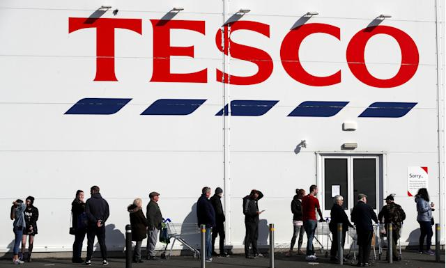 People queue outside a Tesco Extra store in Madeley, Shropshire, on Sunday. (PA Images via Getty Images)