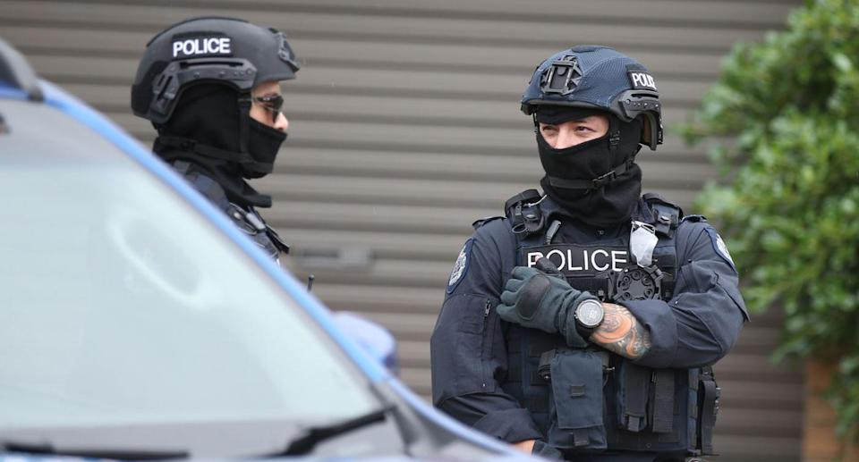 Police are seen outside one of the houses involved in counter terrorism raids across the north-western suburbs in Melbourne. Source: AAP