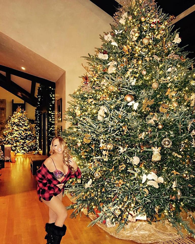 """<p>Mariah Carey is keeping with her tradition of <a rel=""""nofollow"""" href=""""https://www.yahoo.com/celebrity/news/mariah-carey-walks-dog-aspen-snow-wearing-red-190000813-us-weekly.html?ref=gs"""">not wearing much</a> while in Aspen. The singer touched down in Colorado for her annual holiday trip and showed off the enormous Christmas tree set up in her rental home while sporting a festive bra, a buffalo plaid shirt, and black winter boots. Welcome to <i>Mariah's World</i>.(Photo: <a rel=""""nofollow"""" href=""""https://www.instagram.com/p/BOPzpOvhIqd/"""">Instagram</a> </p>"""