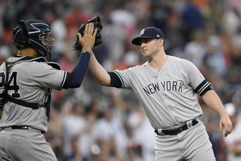 New York Yankees relief pitcher Zack Britton, right, celebrates with catcher Gary Sanchez (24) after a baseball game against the Baltimore Orioles, Thursday, May 23, 2019, in Baltimore. The Yankees won 6-5. (AP Photo/Nick Wass)