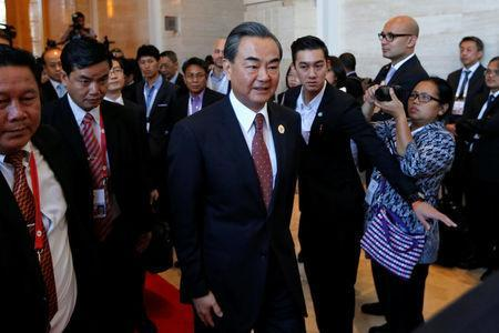 China's Foreign Minister Wang Yi arrives at a meeting at the sidelines of the ASEAN foreign ministers meeting in Vientiane, Laos July 25, 2016. REUTERS/Jorge Silva