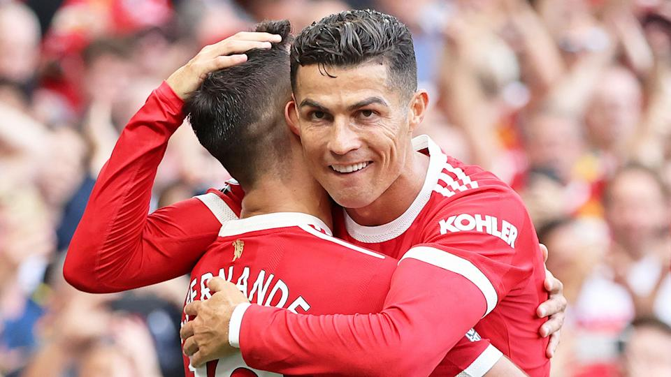 Pictured here, Cristiano Ronaldo hugs a teammates after making his return to Manchester United.