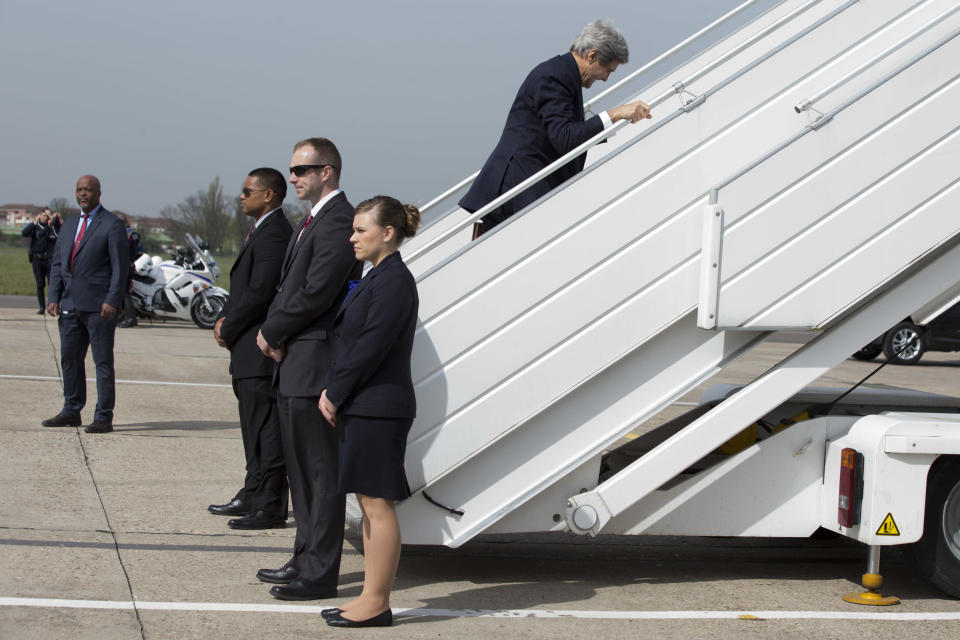 In this March 31, 2014, photo, U.S. Secretary of State John Kerry, right, leaves Paris, for a trip to the Middle East to work on talks about the Middle East peace process. The current trip was to have been a five-day trip to Europe and Saudi Arabia, but with crisis on multiple fronts and Kerry's decision on how to proceed turned a routine trip abroad into a frenetic tour of high-stakes diplomacy marked by abrupt changes in plan that have come to define his 14-month tenure as secretary of state. (AP Photo/Jacquelyn Martin, Pool)