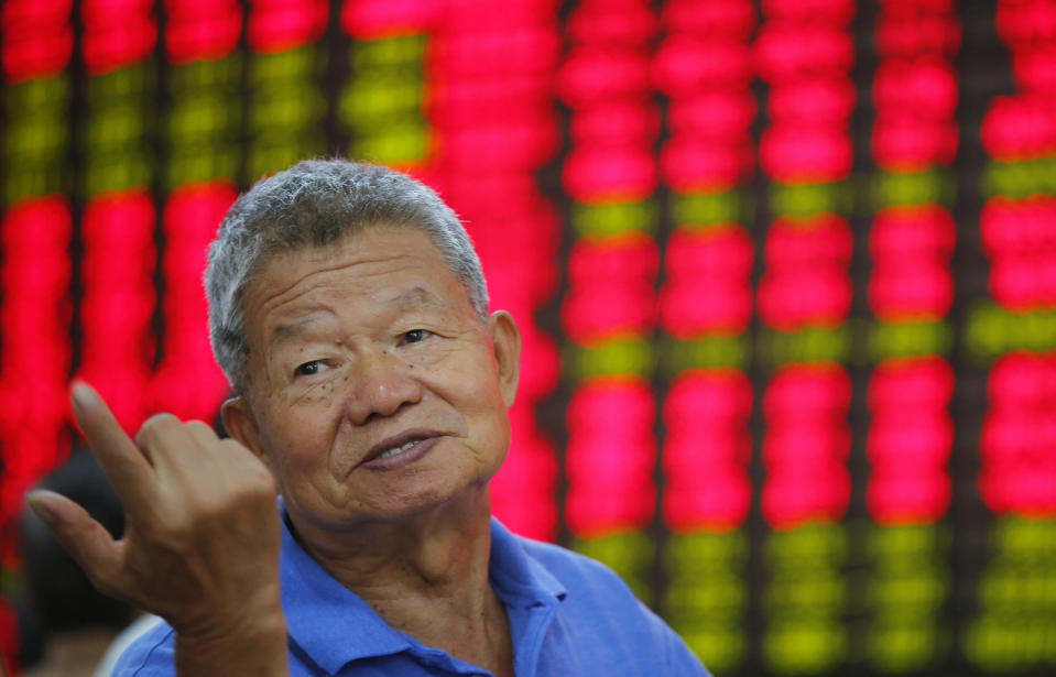 <p> An investor gestures at a private securities company Monday Aug. 19, 2013 in Shanghai, China. Asian stock markets were little changed Monday as traders weighed the consequences of an anticipated phasing out of the U.S. central bank's unprecedented stimulus program. (AP Photo)</p>