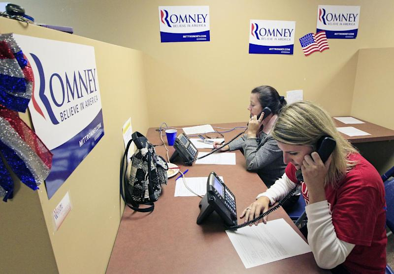 In this photo taken Oct. 2, 2012, Catherine Gatewood, foreground, and Karen Diehl call potential voters from a Republican phone bank, in Cincinnati. Winning Ohio is complicated, with its variety of voter groups and swinging trends. Diverse in geography, economy and demographics, Ohio is a state that one political scientist says offers a fairly close mirror of the nation. History and electoral math say the swing state is pivotal again this year, and probably crucial for Mitt Romney to win. President Barack Obama is trying to repeat his 2008 victory. (AP Photo/Al Behrman)