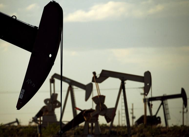 FILE - In this April 24, 2015 file photo, pumpjacks work in a field near Lovington, N.M. With more barrels of oil being pumped monthly from the Permian Basin, New Mexico is among the nation's top producing states. (AP Photo/Charlie Riedel, File)