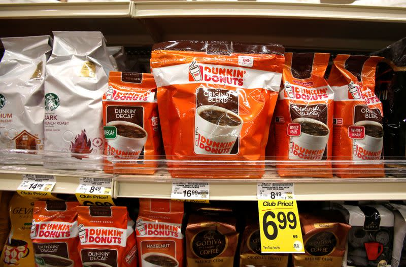 FILE PHOTO: Dunkin' Donuts coffee packs are pictured alongside other coffee brands on the shelves of a grocery store in Pasadena