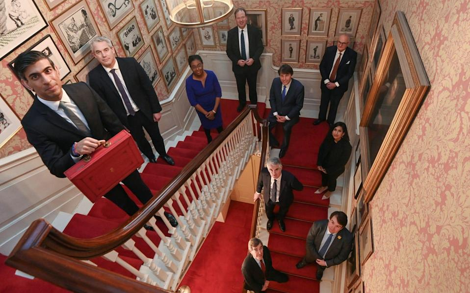 The treasury team in the stairwell - PA