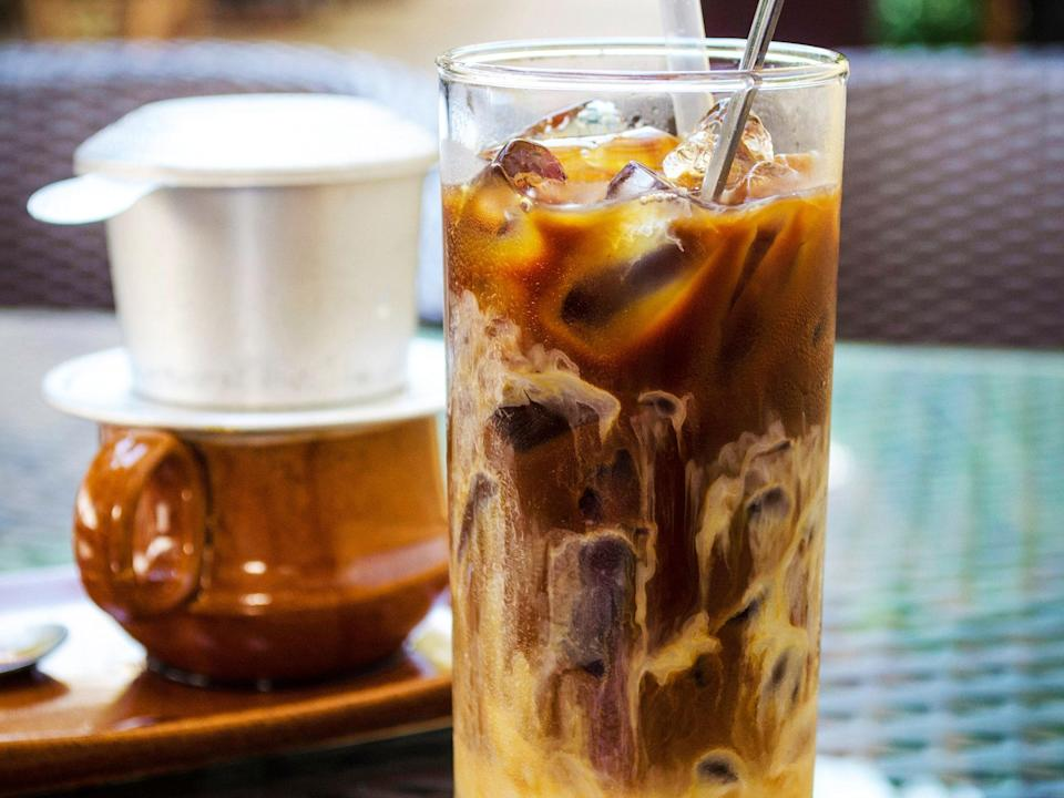 """<p>In this beloved drink, coarsely ground dark roast coffee beans are slowly strained through a traditional Vietnamese coffee press, known as a cà phê phin, and then mixed with sweetened condensed milk and plenty of cracked ice for an intensely flavored, refreshing sip.</p> <p><strong>Try it at home:</strong> <a href=""""https://fave.co/2VeXtGh"""" rel=""""nofollow noopener"""" target=""""_blank"""" data-ylk=""""slk:$29 Vietnamese coffee filter at wayfair.com"""" class=""""link rapid-noclick-resp"""">$29 Vietnamese coffee filter at wayfair.com</a></p>"""