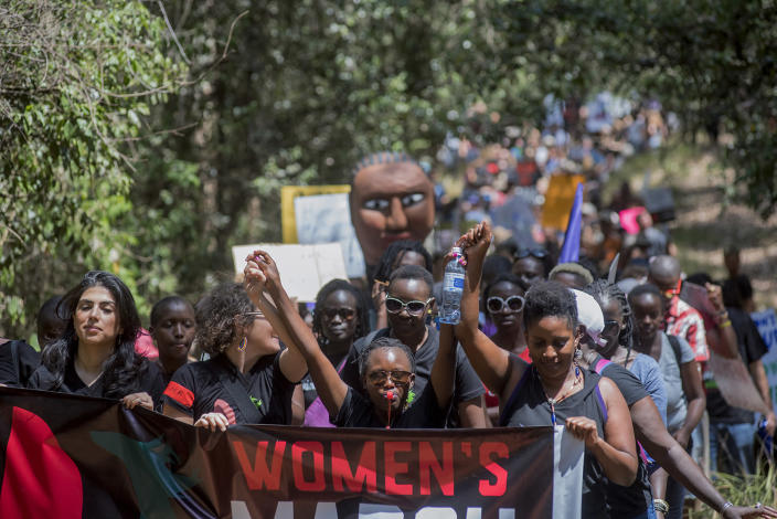 <p>More than 400 people participates in the Nairobi Women's March in Karura Forest, Kenya, on Jan. 21. (Photo: Christena Dowsett for Yahoo News) </p>