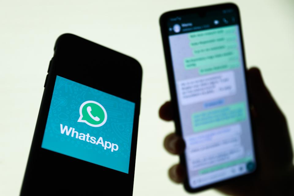 WhatsApp logo displayed on a phone screen and conversation on the WhatsApp displayed on a phone screen in the background are seen in this illustration photo taken in Krakow, Poland on August 27, 2021. (Photo Illustration by Jakub Porzycki/NurPhoto via Getty Images)