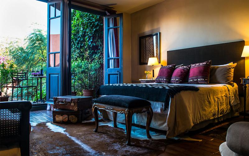 Be Jardín Escondido's interiors are a celebration of Argentine antique textiles, red floor tiles, hide rugs and indigenous carnival masks