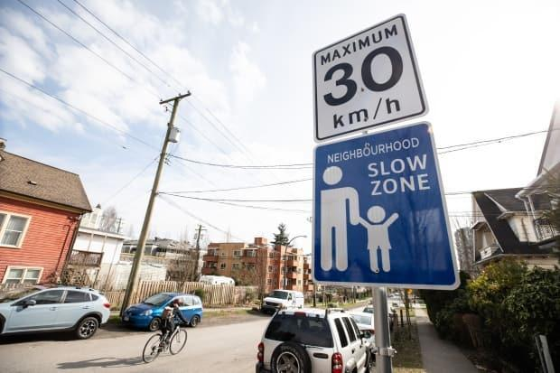 Neighbourhood slow zone road sign on Woodland Drive in Vancouver, British Columbia on Wednesday, March 3, 2021.  (Maggie MacPherson/CBC - image credit)