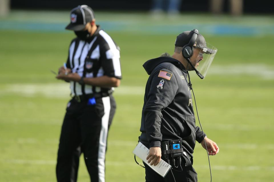 Carolina Panthers head coach Matt Rhule walks on the field against the Tampa Bay Buccaneers during the first half of an NFL football game, Sunday, Nov. 15, 2020, in Charlotte , N.C. (AP Photo/Brian Blanco)