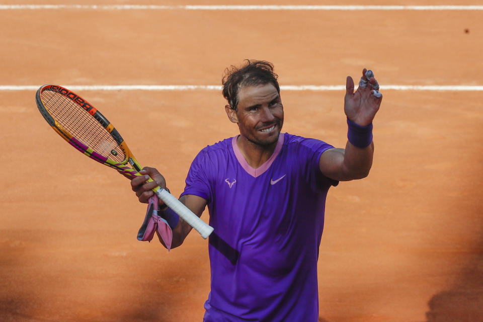 Spain's Rafael Nadal celebrates after beating Canada's Denis Shapovalov, in their 3rd round match at the Italian Open tennis tournament, in Rome, Thursday, May 13, 2021. Nadal won 6-3, 4-6, 6-7. (AP Photo/Alessandra Tarantino)