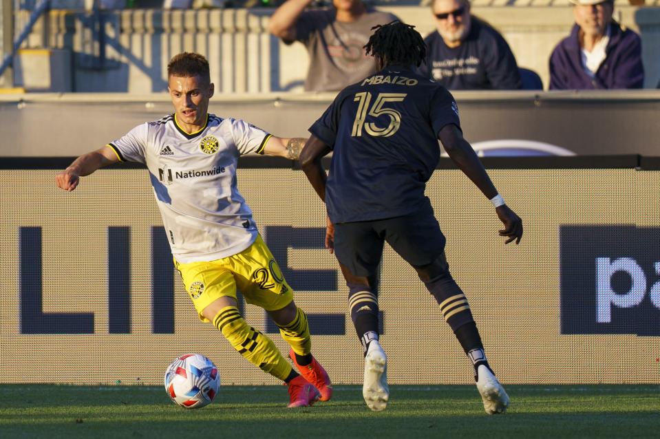 Columbus Crew's Alexandru Matan, left, makes his move against Philadelphia Union's Olivier Mbaizo, left during the first half of an MLS soccer match, Wednesday, June 23, 2021, in Chester, Pa. (AP Photo/Chris Szagola)