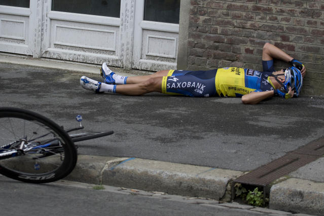 Jonathan Cantwell of Australia holds his head after crashing in the last kilometers of the fifth stage of the Tour de France cycling race over 196.5 kilometers (122 miles) with start in Rouen and finish in Saint-Quentin, France, Thursday July 5, 2012. (AP Photo/Joel Saget, Pool)