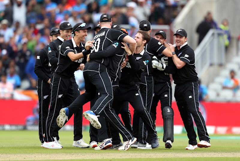 New Zealand players celebrate after India's MS Dhoni is run out during the ICC World Cup Semi Final at Old Trafford Manchester