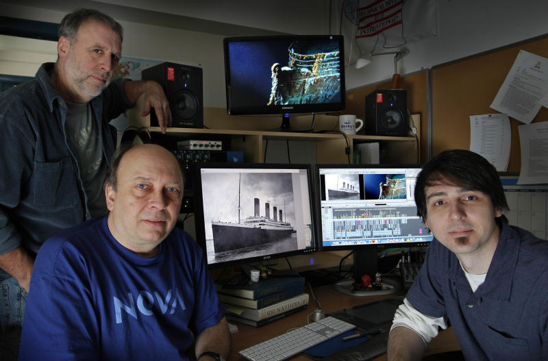 Kirk Wolfinger, top left, Rushmore DeNooyer, and Tony Bacon of the Lone Wolf Documentary Group, pose at an editing station Thursday, March 8, 2010, in South Portland, Maine. The editors are putting the final touches on a History Channel documentary about the mapping of the 3-by-5-mile debris field of the Titanic on the bottom of the North Atlantic Ocean.  The luxury passenger liner sank about 375 miles south of Newfoundland, Canada, after striking an iceberg on its maiden voyage from England to New York on April 15, 1912, killing 1,517 people.  (AP Photo/Robert F. Bukaty)