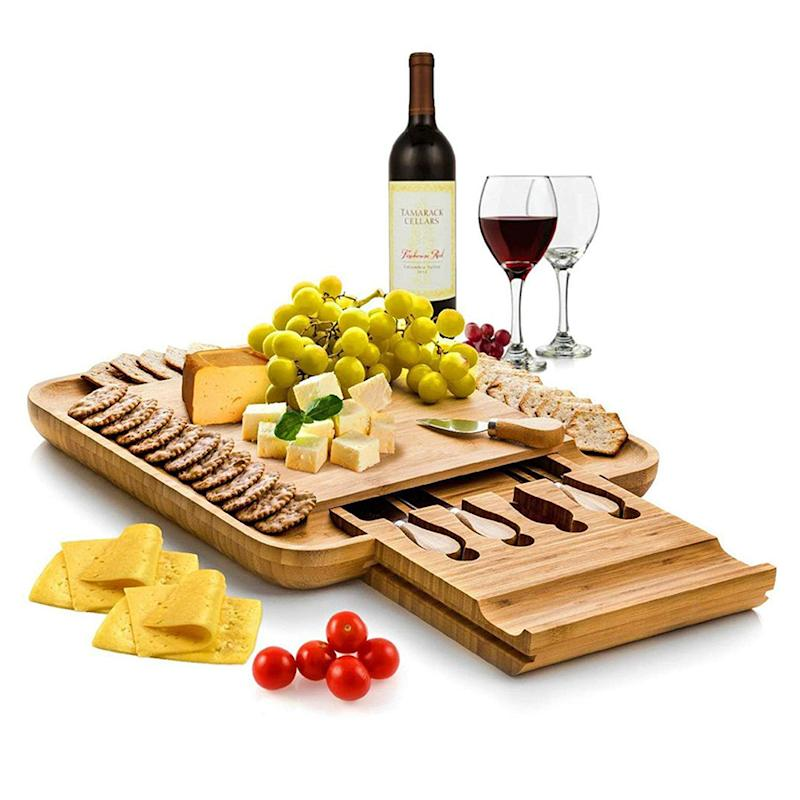 Bamboo Cheese Board with Cutlery Set. (Photo: Amazon)