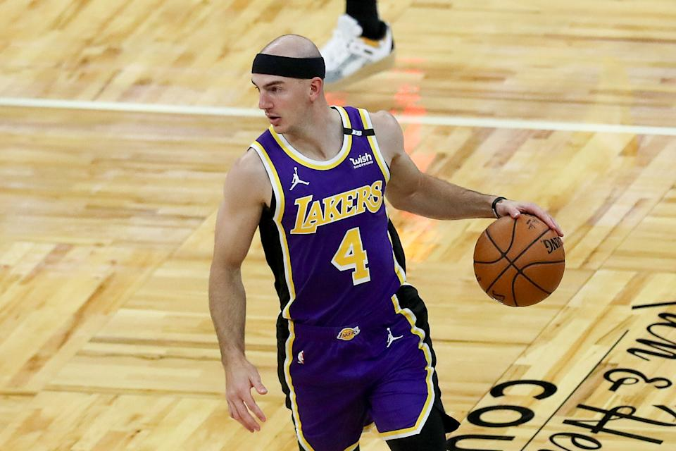 Alex Caruso #4 of the Los Angeles Lakers controls the ball against the Orlando Magic at Amway Center on April 26, 2021 in Orlando, Florida. NOTE TO USER: User expressly acknowledges and agrees that, by downloading and or using this photograph, User is consenting to the terms and conditions of the Getty Images License Agreement. (Photo by Alex Menendez/Getty Images)
