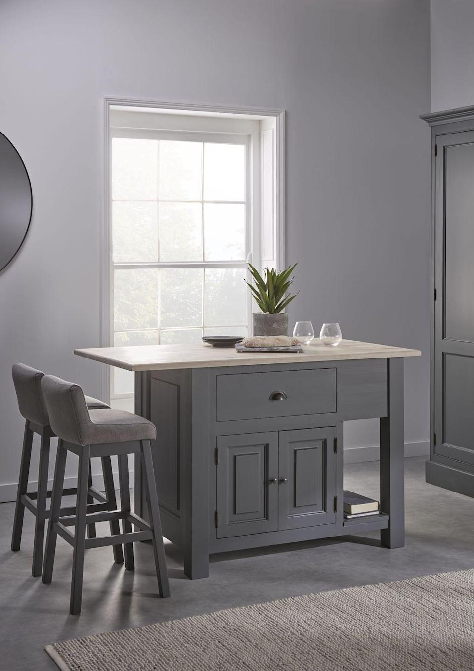 """<p>No space? No problem! You don't need a massive kitchen for an island. For a small kitchen island, there are tons of compact styles available, including this cool grey design from Cox & Cox. It provides space to sit and it's brilliant for providing extra storage for cookbooks, plants and utensils. </p><p>• Mette Island Unit, £1,375, from <a href=""""https://go.redirectingat.com?id=127X1599956&url=https%3A%2F%2Fwww.coxandcox.co.uk%2Fmette-island-unit%2F&sref=https%3A%2F%2Fwww.housebeautiful.com%2Fuk%2Fdecorate%2Fkitchen%2Fg36940747%2Fkitchen-island-ideas%2F"""" rel=""""nofollow noopener"""" target=""""_blank"""" data-ylk=""""slk:Cox & Cox"""" class=""""link rapid-noclick-resp"""">Cox & Cox</a> </p>"""