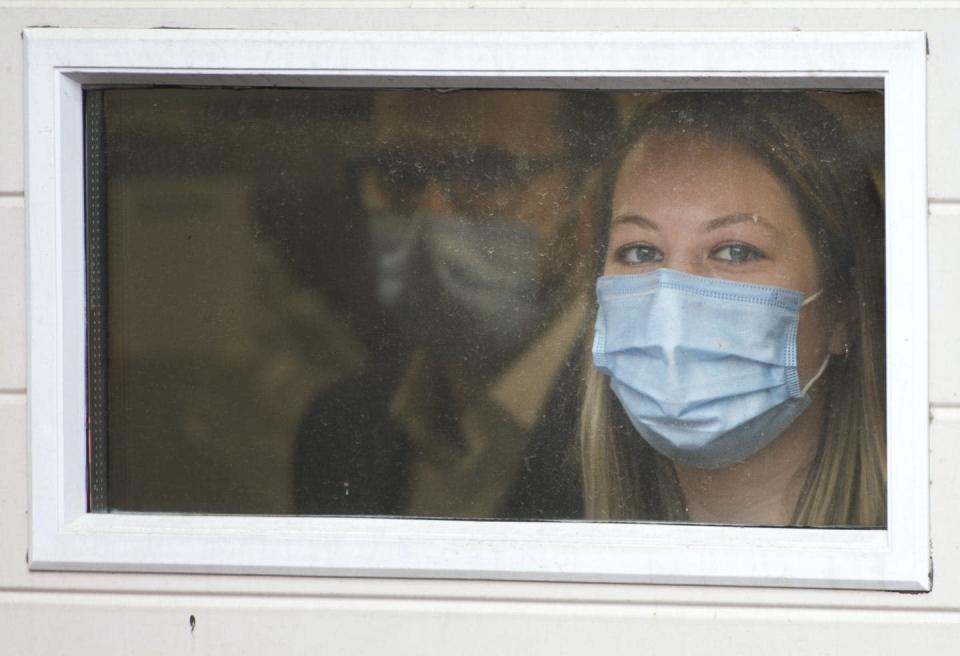 """<span class=""""caption"""">One of the most common reactions during a crisis is the urge to help others. Here a health-care worker watches as the first doses of the Pfizer-BioNTech COVID-19 vaccine are delivered to a long-term care facility in Montréal.</span> <span class=""""attribution""""><span class=""""source"""">THE CANADIAN PRESS/Ryan Remiorz</span></span>"""