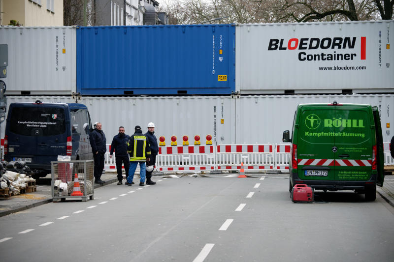 A road is blocked with containers in Dortmund, Germany, Sunday, Jan. 12, 2020. Thousands of people are evacuating in the western Germany city of Dortmund as experts are getting ready to defuse up to four bombs from World War II. (Henning Kaiser/dpa via AP)