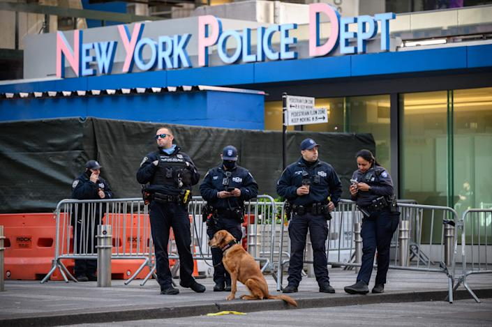 Police officers standing outside the Times Square police station.  (AFP via Getty Images)
