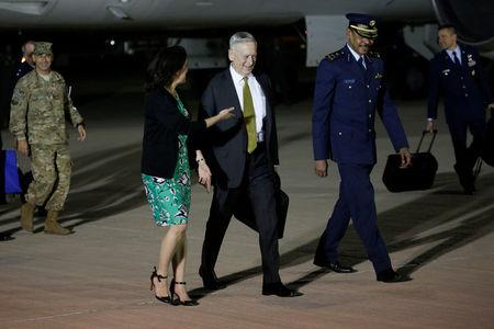 Mattis is greeted by Smith and Hamad as he arrives at Al Udeid Air Base in Doha, Qatar