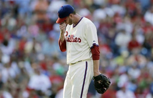 Philadelphia Phillies starting pitcher Roy Halladay wipes his face as he walks off the field after being pulled in the second inning of a baseball game against the Atlanta Braves, Saturday, Sept. 22, 2012, in Philadelphia. (AP Photo/Matt Slocum)