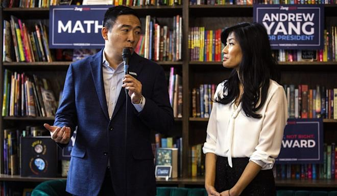 Andrew Yang, then a Democratic presidential candidate, and his wife, Evelyn Yang, campaigning in Iowa in December. Photo: Joseph Cress/Iowa City Press-Citizen via AP