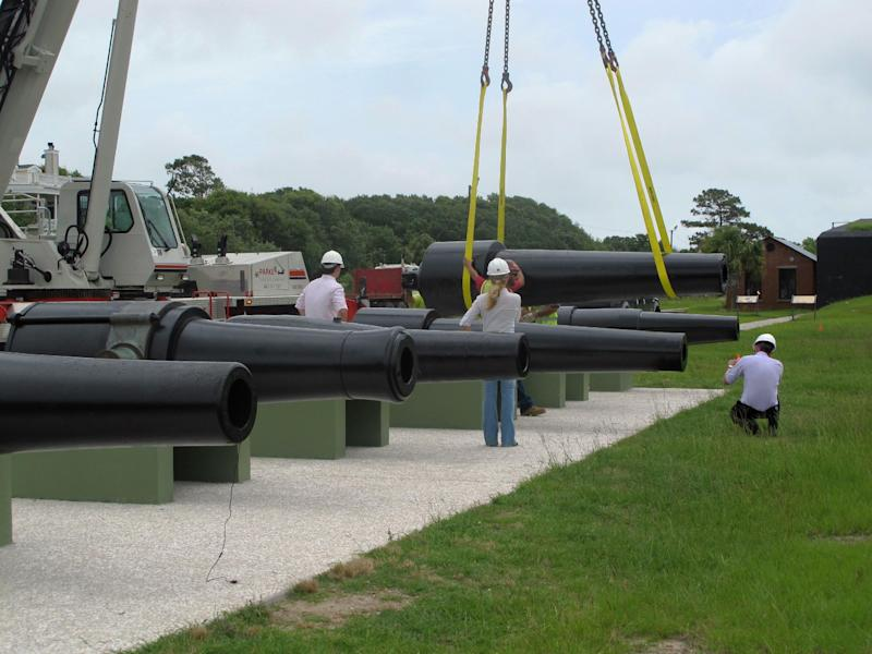 Workers move a Civil War cannon into position at Fort Moultrie on Sullivans Island, S.C., on June 10, 2013, after the gun was conserved. The fort, part of the Fort Sumter National Monument and from which Confederate gunners fired at Sumter in Charleston Harbor to open the Civil War in 1861, recently conserved 10 large cannon. The National Park Service is using computer sensors to monitor the temperature and humidity inside the guns. (AP Photo/Bruce Smith)