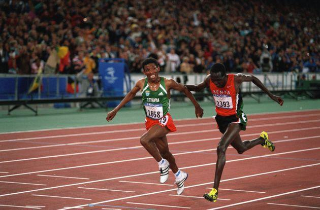 Haile Gebrselassie from Ethiopia and Paul Tergat from Kenya at the finish line of the men's 10,000-meters of the 2000 Olympics. Gebrselassie (L) won gold.   (Photo by Dimitri Iundt/Corbis/VCG via Getty Images) (Photo: Dimitri Iundt via Getty Images)
