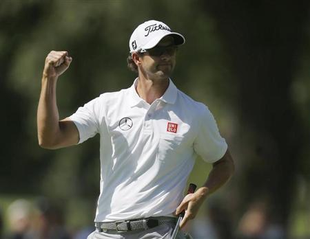 Australia's Adam Scott reacts after his birdie on the first hole during the third round of the 2013 PGA Championship golf tournament at Oak Hill Country Club in Rochester