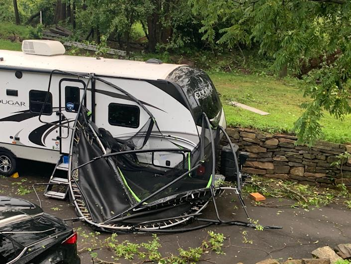 A trampoline lays next to an RV in the driveway of a home in Plumstead on Thursday, July 29, 2021.