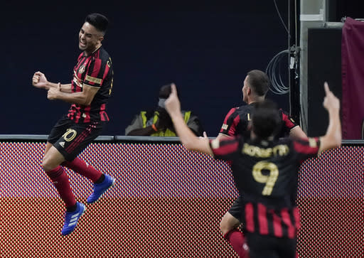 Atlanta United midfielder Gonzalo Martinez, left, celebrates after scoring a goal during the first half of an MLS soccer match against Nashville SC, Saturday, Aug. 22, 2020, in Atlanta. (AP Photo/Brynn Anderson)