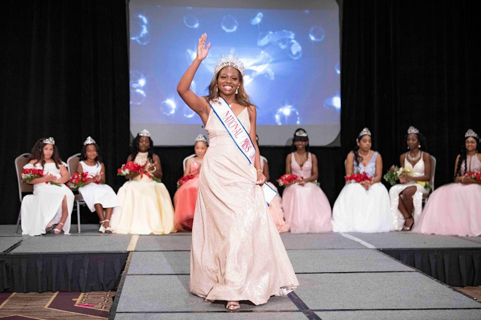 Miss National and Delaware Juneteenth 2020 winner Saniya Gay, 18, walks in the showcase portion of the Delaware Juneteenth Family Enrichment Program and Pageant before helping to present awards to the 2021 contestants at the DoubleTree Hilton Hotel Downtown in Wilmington on June 13, 2021.