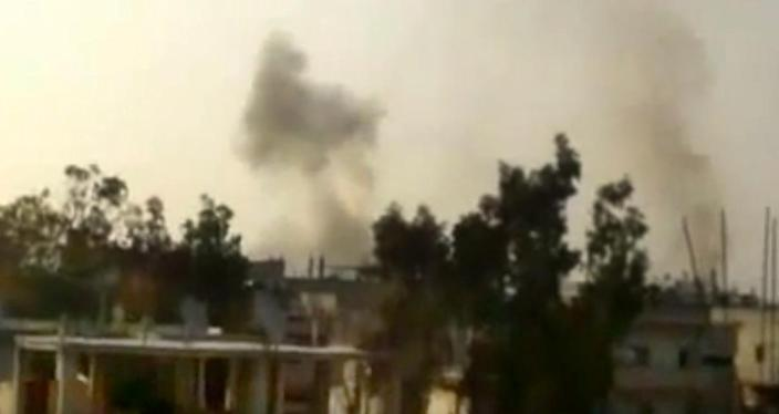 In this image made from amateur video released by the Shaam News Network and accessed Thursday, June 21, 2012, smoke leaps the air from purported shelling in Homs, Syria. A spokeswoman for the International Committee of the Red Cross says aid workers teams will try to evacuate wounded and sick civilians and those who want to leave rebel-held areas in the embattled central Syrian city of Homs. (AP Photo/Shaam News Network via AP video) TV OUT, THE ASSOCIATED PRESS CANNOT INDEPENDENTLY VERIFY THE CONTENT, DATE, LOCATION OR AUTHENTICITY OF THIS MATERIAL