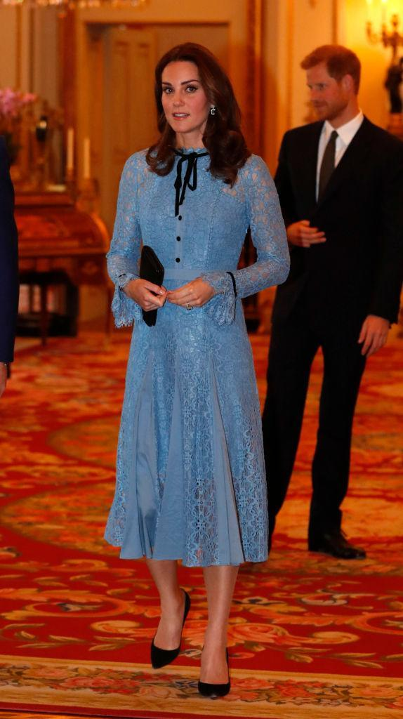 <p>Kate made her first public appearance after announcing that she is pregnant with her third child at Buckingham Palace on October 10.<br>She opted for a blue lace number by Temperley London known as the 'Eclipse' dress. <em>[Photo: Getty]</em> </p>